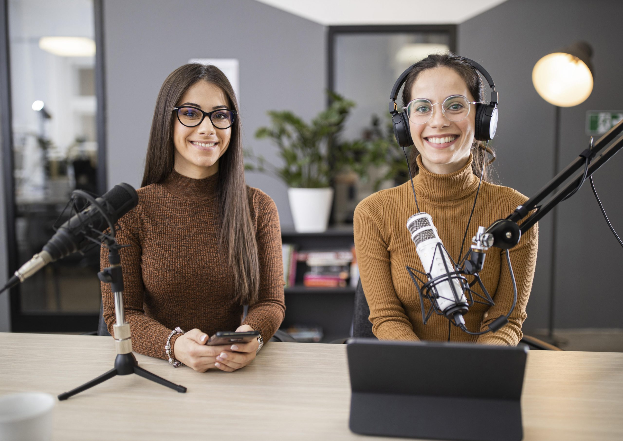 Women entrepreneurs hosting a successful small business podcast.